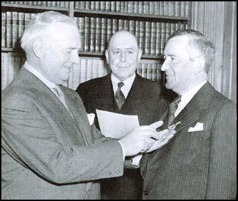 Donovan pinning medal of merit on William Stephenson