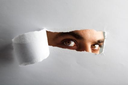 eyes-looking-through-torn-paper
