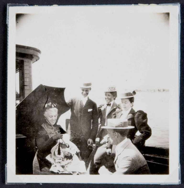 Baby E.H. Cushing held by his grandmother, - Harvey Cushing right 1898